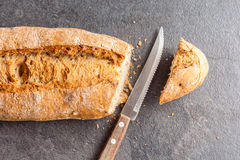 Sliced bread and knife Stock Photos
