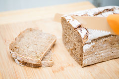 Sliced bread and knife Royalty Free Stock Images