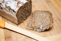 Sliced bread and knife Royalty Free Stock Photo