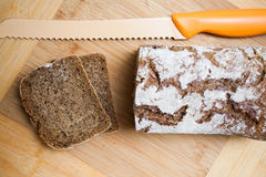 Sliced bread and knife Royalty Free Stock Image