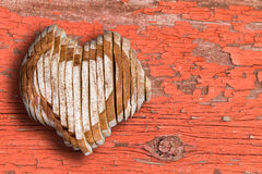 Sliced bread loaf shaped as heart over old surface Royalty Free Stock Photography