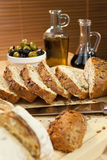 Sliced Bread, Olive Oil, Green & Black Olives Stock Images