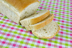 Sliced bread with olives on colorful table cloth background Stock Photos