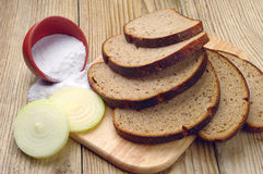 Sliced bread, onion and salt Royalty Free Stock Images