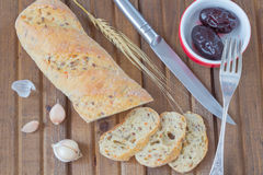 Sliced bread, pickled plum on the plate, pepper, knife Stock Photography