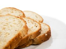 Sliced bread on plate. Royalty Free Stock Image