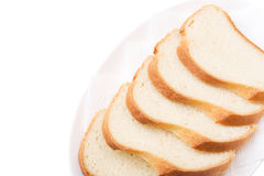Sliced Bread on the plate. Bon appetit!. Sliced Bread on the plate isolated over white. Bon appetit royalty free stock photo
