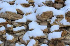 snow-covered stones fencing houses royalty free stock images