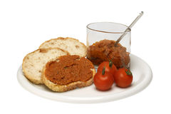 Sliced bread with red pesto sauce Royalty Free Stock Images