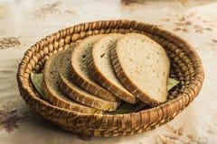 Sliced bread - retro photo. Sliced bread in a wicker basket royalty free stock photo