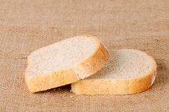 Sliced bread on sackcloth Stock Images