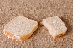 Sliced bread on sackcloth Stock Photography