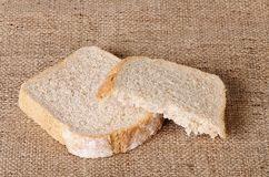 Sliced bread on sackcloth Royalty Free Stock Images