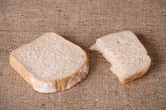 Sliced bread on sackcloth Royalty Free Stock Photo