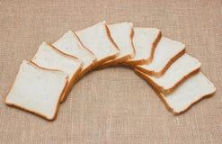 Sliced bread on sacking Stock Photo