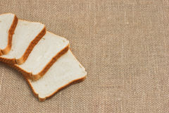 Sliced bread on sacking Royalty Free Stock Photography