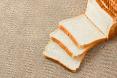 Sliced bread on sacking Stock Images