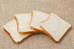 Sliced bread on sacking Royalty Free Stock Images