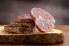 Sliced bread with salami royalty free stock image