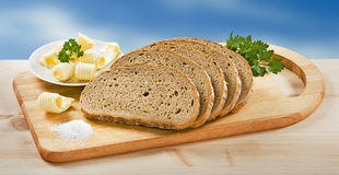 Sliced bread, salt and butter Stock Photography
