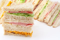 Sliced Bread Sandwich platter. Selection of Sandwiches in front of a platter of various fillings at buffet Royalty Free Stock Photo