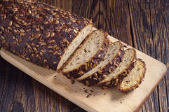 Sliced bread with seeds Stock Images