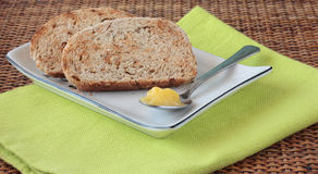 Sliced bread with seeds and ghee Royalty Free Stock Photo