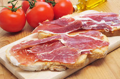Sliced of bread with serrano ham served as tapas Stock Photos