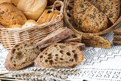 Sliced bread on a tablecloth and in a basket Royalty Free Stock Images