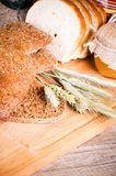 Sliced bread and wheat Royalty Free Stock Images