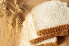 Sliced Bread and Wheat Stock Image