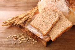 Sliced bread with wheat spikes Royalty Free Stock Photo