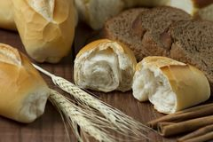 Sliced Bread Beside Wheat on Table Stock Photo
