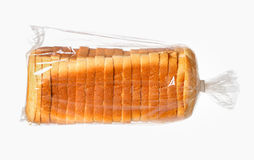 Sliced bread on white surface. Sliced bread in a plastic bag on white surface Stock Photography