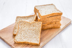 Sliced bread on white wooden table Royalty Free Stock Photo