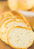 Sliced bread on a wood background, warm toning, selective fo Royalty Free Stock Images