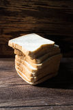 Sliced bread on wooden background Stock Images