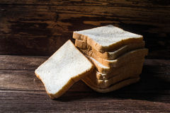 Sliced bread on wooden background Royalty Free Stock Images