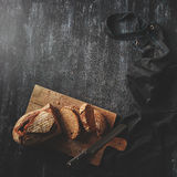 Sliced bread on wooden board Royalty Free Stock Image