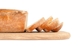 Sliced bread on a wooden chopping board Royalty Free Stock Photography