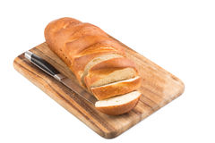 Sliced bread on a wooden chopping board Royalty Free Stock Images