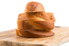 Sliced bread on a wooden chopping board Stock Photography