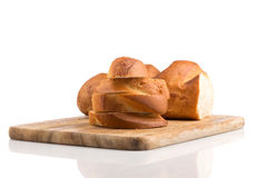 Sliced bread on a wooden chopping board Stock Image