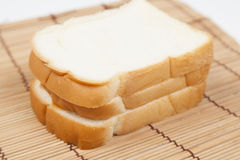 Sliced bread on the wooden plate. Stock Photography