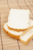 Sliced bread on the wooden plate. Stock Photo