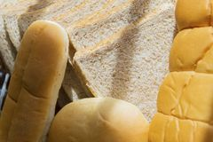 Sliced breads and fresh breads. Close up of sliced breads and fresh breads to breakfast on the dining table Royalty Free Stock Image