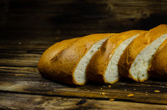 Sliced bred on wooden table Royalty Free Stock Image