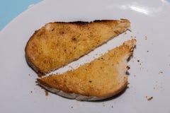 Sliced bredde smör på rostat bröd Royaltyfri Fotografi