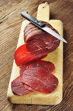 Sliced bresaola on a cutting board Royalty Free Stock Photos
