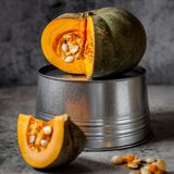 Pumkin over Grey Background. Sliced Bright Orange Pumkin over Grey Background, square Royalty Free Stock Photography